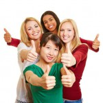 Group of young women holding thumbs up