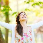 Woman enjoying happiness and hope on spring